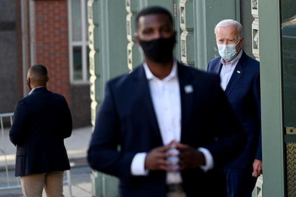 PHOTO: Democratic presidential nominee and former Vice President Joe Biden is surrounded by secret service agents as he exits a local theatre after participating in a virtual town hall meeting in Wilmington, Del., Oct. 3, 2020. (Roberto Schmidt/AFP via Getty Images, FILE)