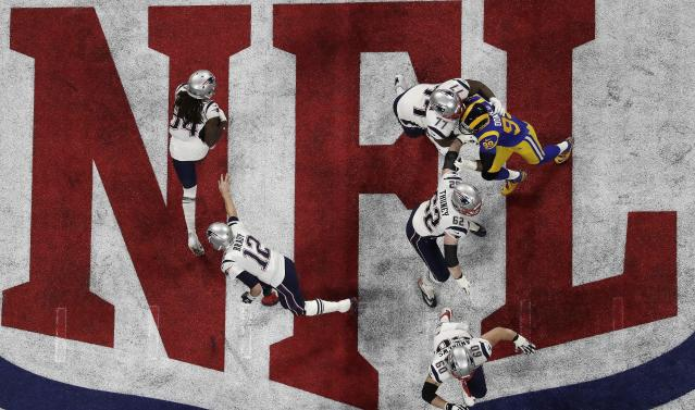 <p>New England Patriots' Tom Brady (12) hands the ball off to Rex Burkhead against the Los Angeles Rams during the first half of the NFL Super Bowl 53 football game Sunday, Feb. 3, 2019, in Atlanta. (AP Photo/Morry Gash) </p>