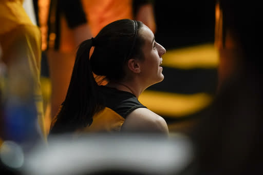 Iowa guard Caitlin Clark sits on the bench before the team's NCAA college basketball game against Ohio State, Wednesday, Jan. 13, 2021, in Iowa City, Iowa. Clark, one of the top scorers in the nation, has been named the Big Ten's player of the week three times this season and has won the conference's freshman of the week honor six times. (AP Photo/Charlie Neibergall)