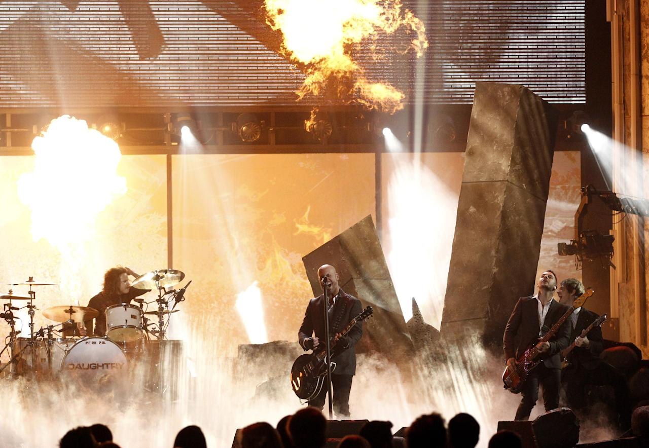 Chris Daughtry of the band Daughtry performs at the 39th Annual American Music Awards on Sunday, Nov. 20, 2011 in Los Angeles. (AP Photo/Matt Sayles)