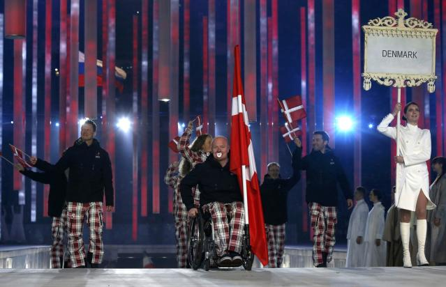 Denmark's flag-bearer Ulrik Nyvold (C), leads his country's contingent during the opening ceremony of the 2014 Paralympic Winter Games in Sochi, March 7, 2014. REUTERS/Alexander Demianchuk (RUSSIA - Tags: OLYMPICS SPORT)