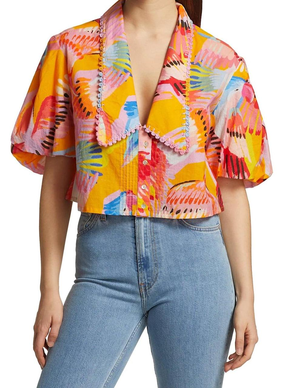 <p>Want an instant mood-booster? Look no further than this <span>Farm Rio Neon Macaws Collar Puff-Sleeve Blouse</span> ($155).</p>