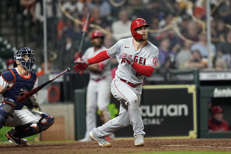 Los Angeles Angels' Jared Walsh, right, hits a home run as Houston Astros catcher Jason Castro watches during the sixth inning of a baseball game Monday, May 10, 2021, in Houston. (AP Photo/David J. Phillip)