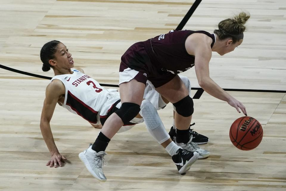 Stanford's Anna Wilson tries to draw a charge on Missouri State's Elle Ruffridge during the first half of an NCAA college basketball game in the Sweet 16 round of the Women's NCAA tournament Sunday, March 28, 2021, at the Alamodome in San Antonio. (AP Photo/Morry Gash)