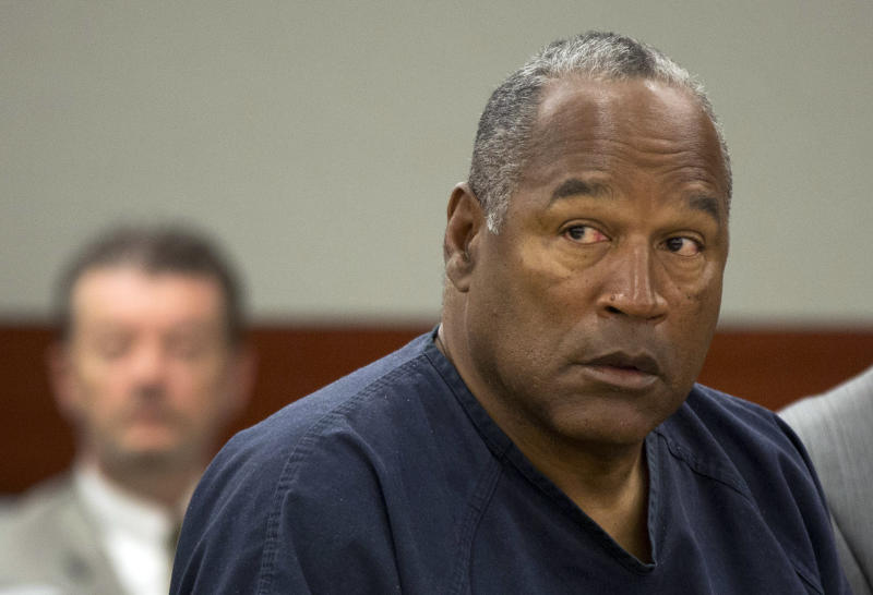 FILE - In this May 16, 2013, file photo, O.J. Simpson listens during an evidentiary hearing in Clark County District Court, in Las Vegas. A judge in Las Vegas rejected Simpson's bid for a new trial on Tuesday, Nov. 26, 2013, dashing the former football star's bid for freedom based on the claim that his original lawyer botched his armed robbery and kidnapping trial in Las Vegas more than five years ago. (AP Photo/Julie Jacobson, Pool, File)