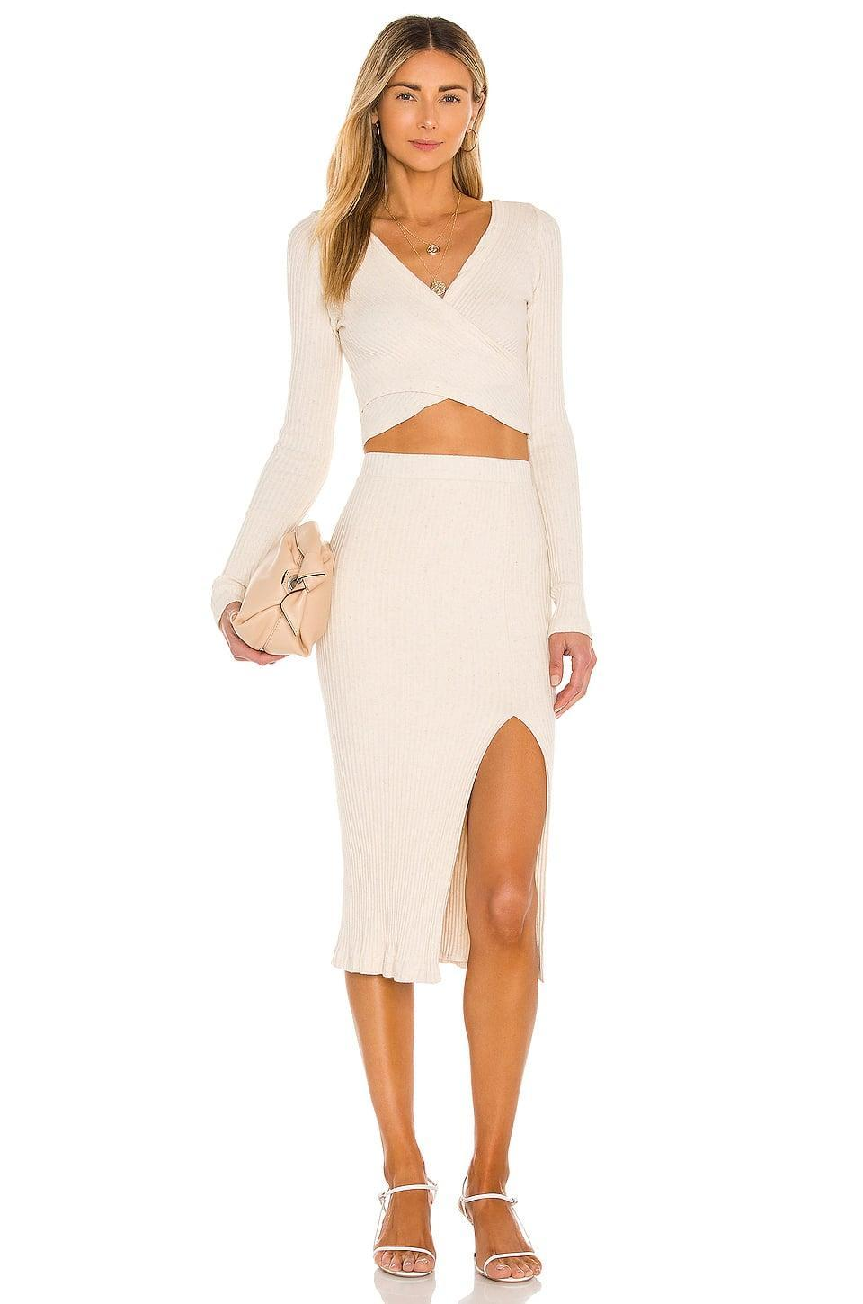 <p>The <span>Krisa Crop Surplice Wrap Blouse</span> ($128) and <span>Bodycon Slit Skirt</span> ($143) are how you look cute while staying comfortable.</p>