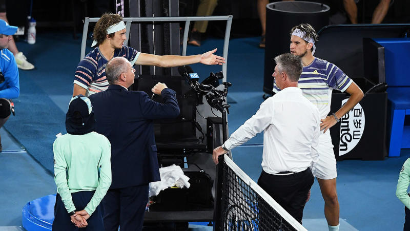 Alexander Zverevpoints to Dominic Thiemduring a delay at the Australian Open.