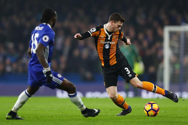 <p>Andrew Robertson takes on fellow wing-back Victor Moses </p>