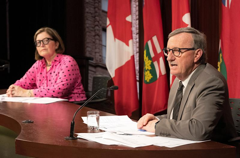 Toronto Medical Officer of Health Dr. Barbara Yaffe (left) listens as Ontario Chief Medical Officer of Health Dr. David Williams speaks at Queen's Park in Toronto on March 25, 2020. (Photo: Frank Gunn/CP)