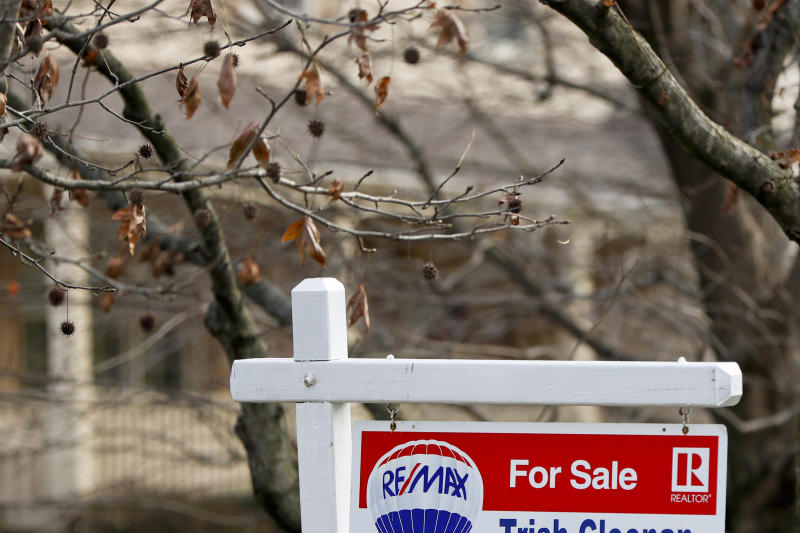FILE - In this Jan. 3, 2019, file photo a realtor sign marks a home for sale in Franklin Park, Pa.  The partial federal government shutdown is complicating the already complicated process of getting and managing a mortgage. For one thing, the political storm is like severe weather at a major airport: You can expect minor delays or worse. Also, it could mean financial hardship for some federal government employees facing mortgage payments without their regular paychecks.  (AP Photo/Keith Srakocic)