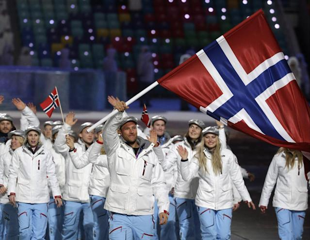 Aksel Lund Svindal of Norway carries the national flag as he leads the team during the opening ceremony of the 2014 Winter Olympics in Sochi, Russia, Friday, Feb. 7, 2014