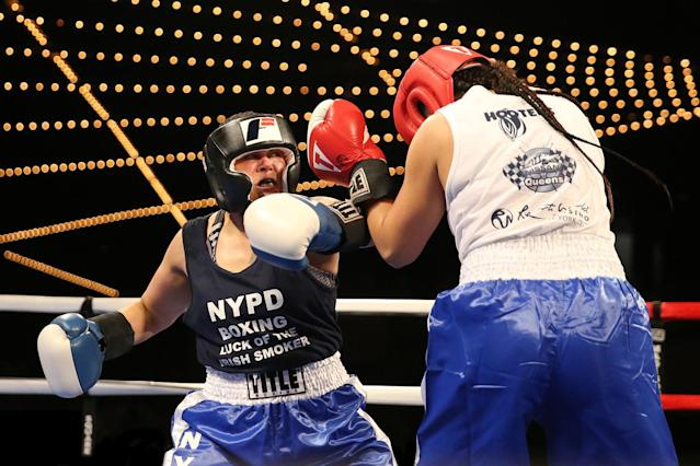 <p>Selina Herrera loads up a punch in the ring against Radwa Mohammed, right, during the NYPD Boxing Championships at the Theater at Madison Square Garden on June 8, 2017. (Photo: Gordon Donovan/Yahoo News) </p>