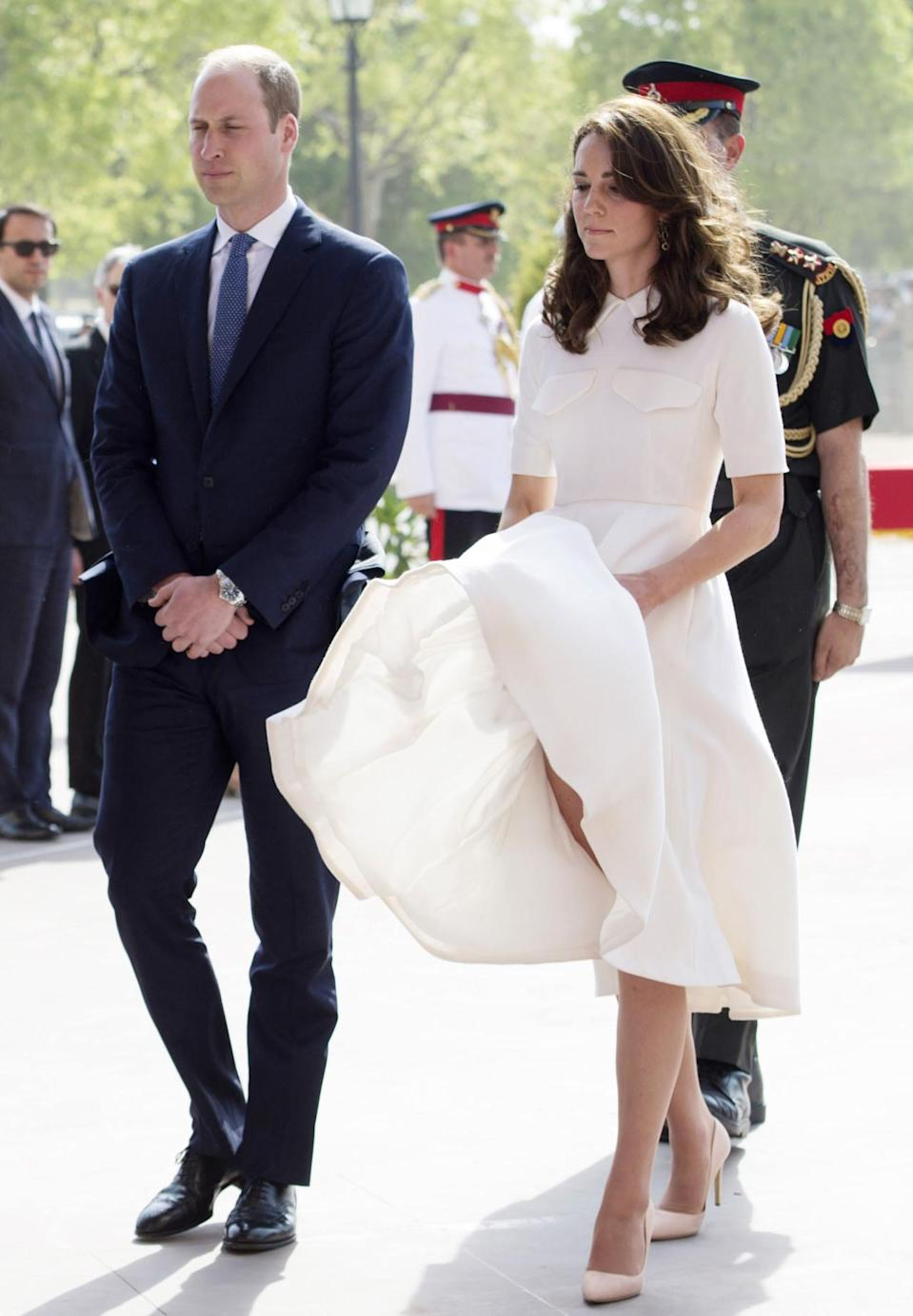 <p>Even Kate experiences the odd wardrobe malfunction. While the Queen and Camilla tend to wear weighted skirts - to avoid this exact situation - the Duchess doesn't tend to. <i>[Photo: Getty]</i></p>