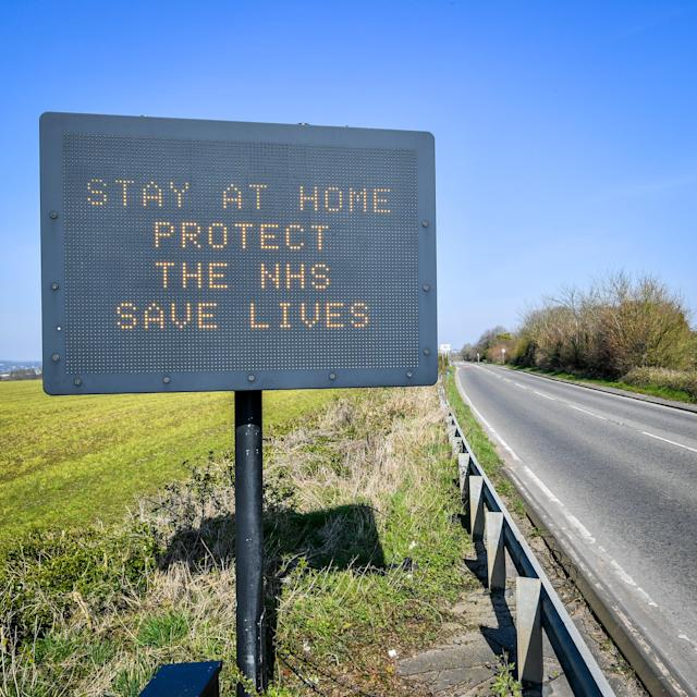 A matrix road sign on the A367 into Bath advises motorists to stay at home to protect the NHS. (PA)