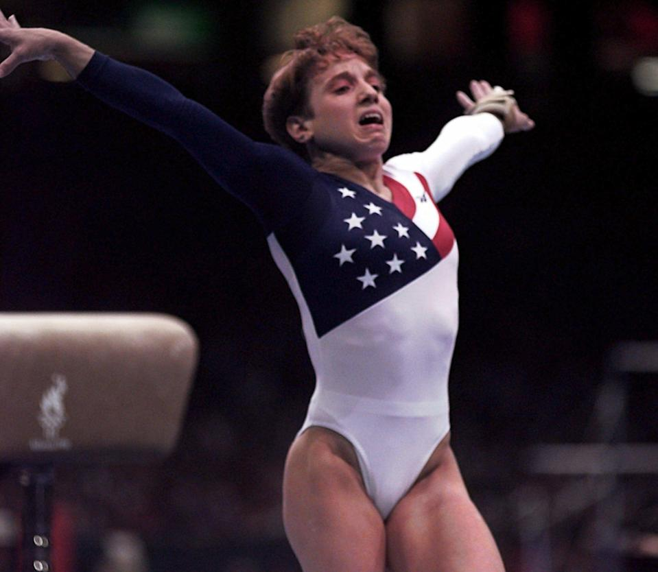 <p>At the 1996 Games in Atlanta, 18-year-old Kerri Strug injured her ankle on her first vault attempt but fought through the pain to stick her landing on the second, helping Team USA beat Russia and claim its first ever team gold in women's gymnastics. (AP) </p>