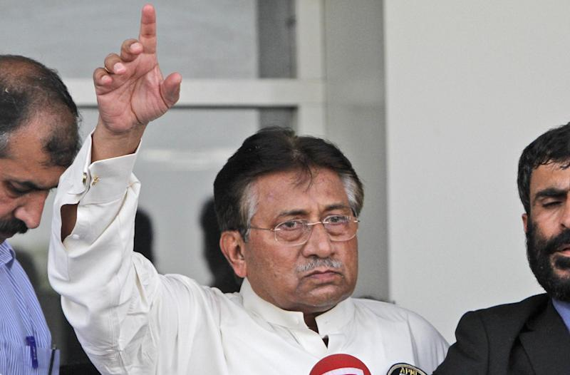 In this Sunday, March 24, 2013 photo, Former Pakistani President Pervez Musharraf, gestures upon his arrival to Karachi airport, Pakistan. Musharraf was given approval on Sunday, April 7, 2013 to run for parliament in a remote northern district after being rejected in two other parts of the country, his aide said. (AP Photo/Shakil Adil)