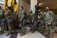 Members of the National Guard gather at inside the Capitol Visitor Center, Wednesday, Jan. 13, 2021, in Washington as the House of Representatives continues with its fast-moving House vote to impeach President Donald Trump, a week after a mob of Trump supporters stormed the U.S. Capitol. (AP Photo/Manuel Balce Ceneta)