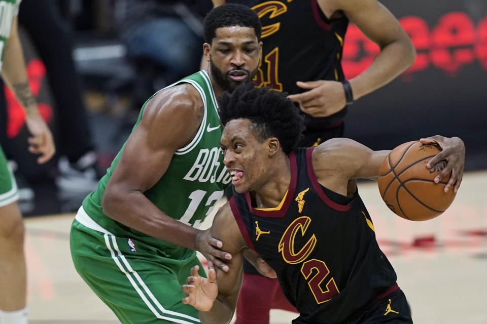 Cleveland Cavaliers' Collin Sexton (2) drives against Boston Celtics' Tristan Thompson (13) during the second half of an NBA basketball game Wednesday, May 12, 2021, in Cleveland. (AP Photo/Tony Dejak)