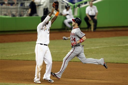 Washington Nationals' Bryce Harper (34) is safe at third with a triple as Miami Marlins third baseman Hanley Ramirez, left, waits for the throw in the sixth inning of a baseball game, Tuesday, May 29, 2012, in Miami. (AP Photo/Lynne Sladky)