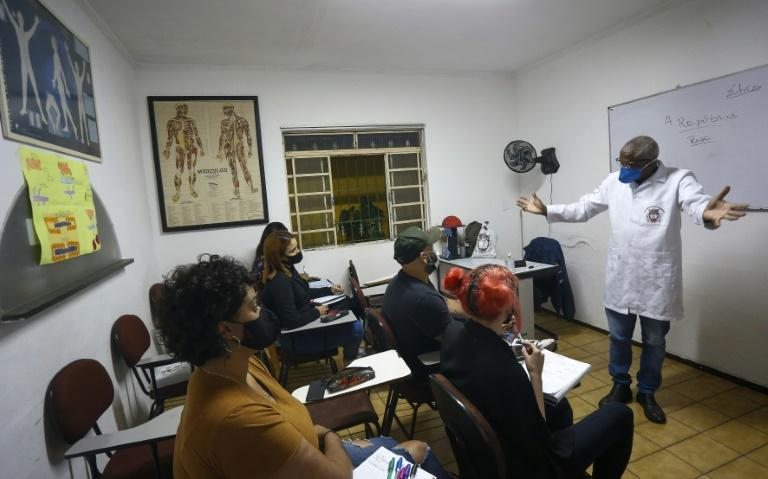 In addition to his work as a gravedigger, Brazilian Osmair Candido is a philosophy teacher, is writing a book and teaches future autopsy experts at a school in Sao Paulo (AFP/Miguel SCHINCARIOL)