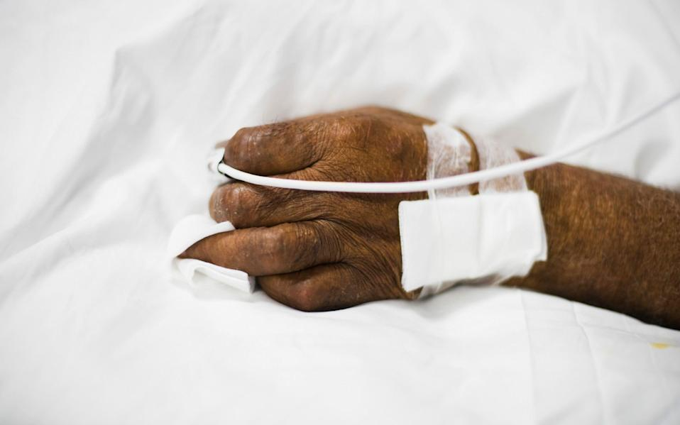 A Covid-19 patient's hand connected to a pulse oximeter in the intensive care unit (ICU) at the Ambroise Pare Clinic in Paris, France - Nathan Laine / Bloomberg
