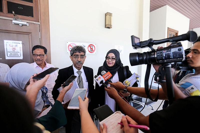 Haniff Khatri Abdulla (left) and Azlina Mehtab Mohd Ishaq (right) speak to reporters at the Penang High Court in George Town January 14, 2019. — Picture by Sayuti Zainudin