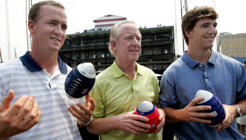 "Archie Manning, center, is flanked by his NFL football quarterback sons Peyton, left, of the Indianapolis Colts, and Eli, of the New York Giants, during a Nerf Father's Day promo Saturday, June 14, 2008, in New York. Archie Manning used to play a game with his sons called ""Amazing Catches,"" where he'd throw the ball just out of their reach and they'd have to make a diving grab. Peyton and Eli have had a lot of amazing passes lately in winning the last two Super Bowl MVP awards. (AP Photo/Stephen Chernin)"