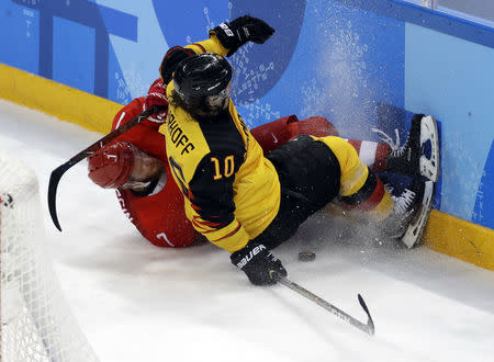Ice Hockey - Pyeongchang 2018 Winter Olympics - Men Final Match - Olympic Athletes from Russia v Germany - Gangneung Hockey Centre, Gangneung, South Korea - February 25, 2018 - Olympic Athlete from Russia Ivan Telegin and Christian Ehrhoff of Germany collide. REUTERS/David W Cerny