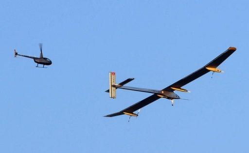 The Swiss-made solar-powered plane, Solar Impulse piloted by Bertrand Piccard, takes off