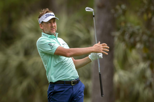 England's Ian Poulter watches his drive off the fourth tee during the final round of the RBC Heritage golf tournament in Hilton Head Island, S.C., Sunday, April 15, 2018. (AP Photo/Stephen B. Morton)