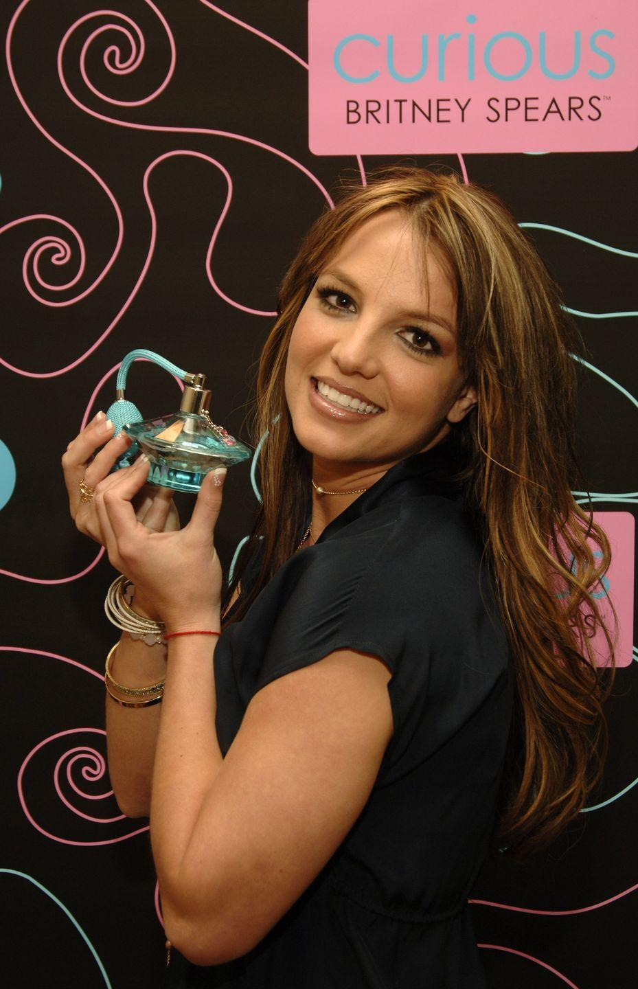 <p>A few months later, Britney made a big change with a chestnut brown color. The darker hue was a dramatic difference, but she kept her go-to long layers and baby bangs. </p>