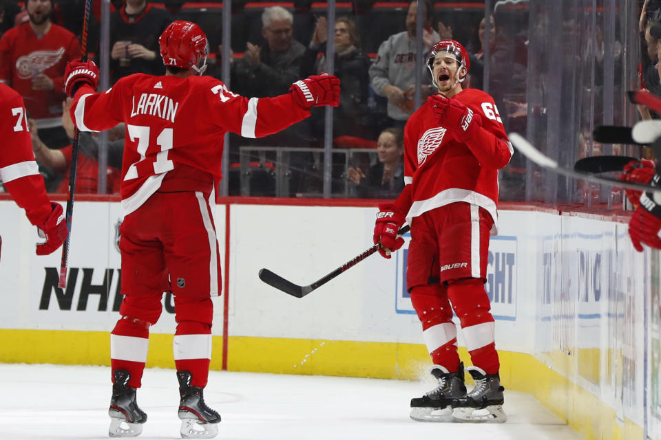 Detroit Red Wings defenseman Danny DeKeyser, right, celebrates his goal with Dylan Larkin (71) during the first period of the team's NHL hockey game against the New Jersey Devils, Friday, March 29, 2019, in Detroit. (AP Photo/Paul Sancya)