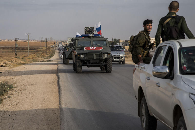 Russian forces patrol near the city of Qamishli, north Syria, Thursday, Oct. 24, 2019. Syrian forces, Russian military advisers and military police are being deployed in a zone 30 kilometers (19 miles) deep along much of the northeastern border, under an agreement reached Tuesday by Russia and Turkey. (AP Photo/Baderkhan Ahmad)