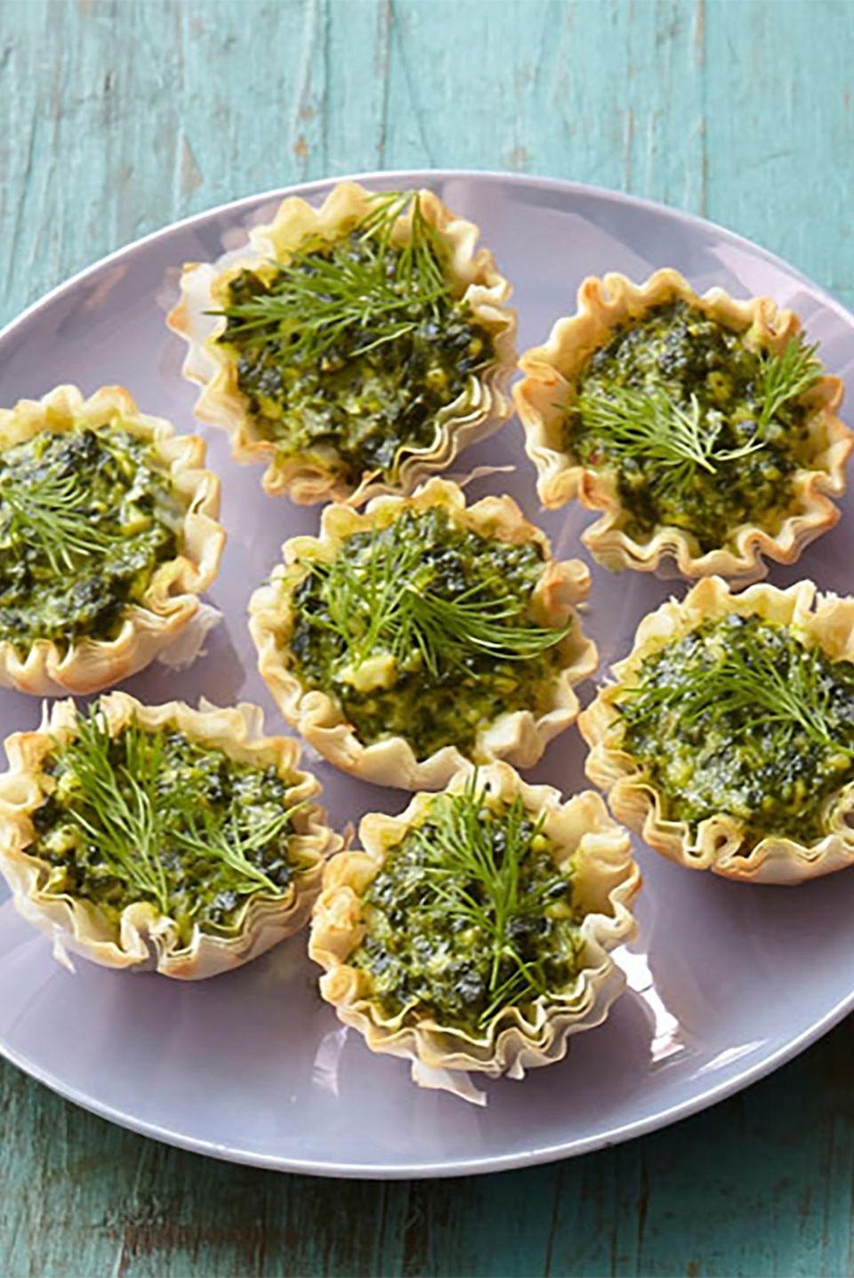"""<p>These Mediterranean-inspired tartlets are filled with spinach, feta cheese, and fresh dill in a crunchy phyllo dough shell.</p><p><strong><a href=""""https://www.countryliving.com/food-drinks/recipes/a34777/feta-spinach-tartlets-recipe-ghk0414/"""" rel=""""nofollow noopener"""" target=""""_blank"""" data-ylk=""""slk:Get the recipe"""" class=""""link rapid-noclick-resp"""">Get the recipe</a>.</strong><br></p>"""