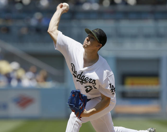 Los Angeles Dodgers starting pitcher Walker Buehler throws to the plate against the San Diego Padres during the first inning of a baseball game in Los Angeles, Sunday, May 27, 2018. (AP Photo/Alex Gallardo)
