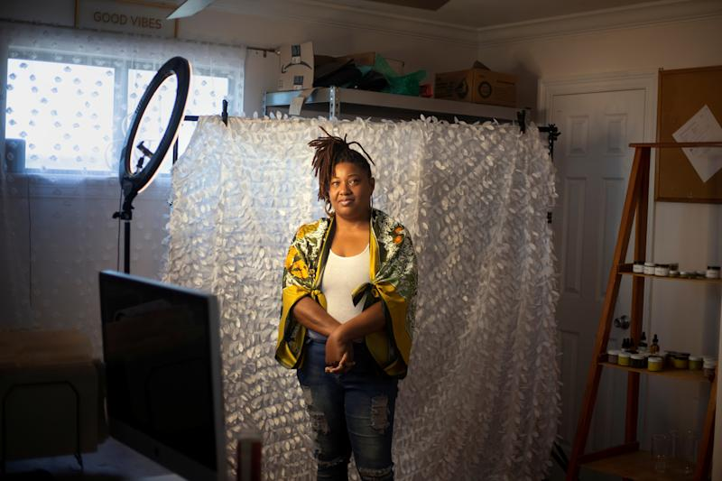 Donica Johns poses for a portrait in her home office in New Orleans, Louisiana, U.S., on June 13, 2020. Johns hasn't benefited much from the aid offered to small business owners during the crisis, and she isn't alone. Many other black owned businesses that didn't have existing banking relationships before the crisis hit are having similar experiences. At the beginning of the year she was in the process of rebranding her skincare business and shopping for an official workspace that would allow her to expand her company. She was forced to put the expansion plans on hold when the coronavirus pandemic hit, and has been struggling to replenish her inventory because of shipping delays caused by the virus. Johns applied for a loan from the Paycheck Protection Program but hasn't heard back. REUTERS/Kathleen Flynn