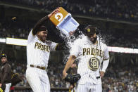 San Diego Padres' Joe Musgrove, left, dumps water onto Eric Hosmer during an interview after the Padres defeated the Cincinnati Reds in a baseball game Thursday, June 17, 2021, in San Diego. (AP Photo/Derrick Tuskan)