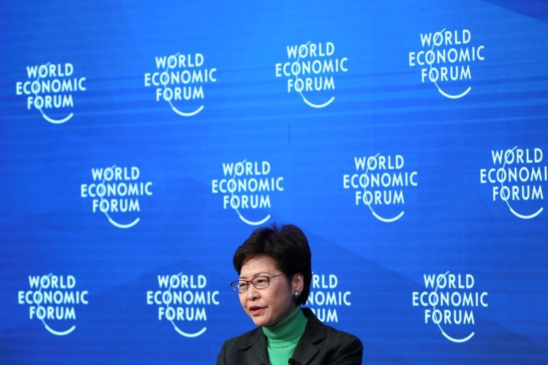Lam courts Davos elite with dim sum, as Hong Kong scrambles to contain virus