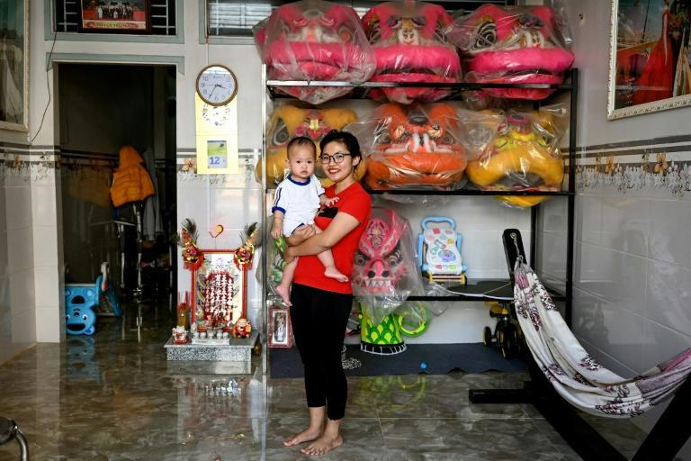 """""""I am proud to be the person who has inspired other girls,"""" says lion dancer Le Yen Quyen whose baby daughter accompanies her to practices"""