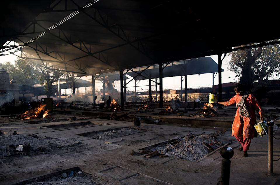 <p>Multiple burning pyres of patients who died of the Covid-19 infections at a crematorium in New Delhi</p> (Getty Images)