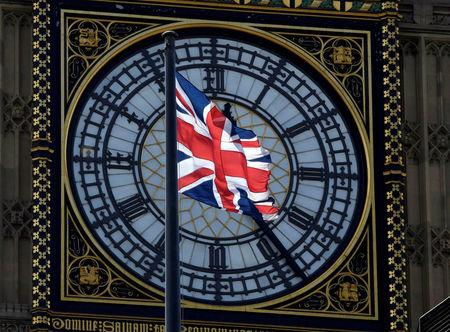 FILE PHOTO: A Union Flag flies in front of the Big Ben clock face abover the Houses of Parliament in central London