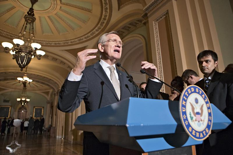 Senate Majority Leader Harry Reid of Nev. gestures as he speaks with reporters on Capitol Hill in Washington, Tuesday, July 23, 2013, following a caucus with Senate Democrats. (AP Photo/J. Scott Applewhite)