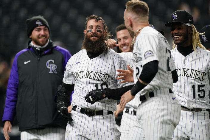 Teammates welcome Colorado Rockies' Charlie Blackmon, center, at home plate after he hit a three-run, walkoff home run off San Francisco Giants relief pitcher Camilo Doval in the seventh inning of game two of a baseball doubleheader Tuesday, May 4, 2021, in Denver. The Rockies won the nightcap by score of 8-6.(AP Photo/David Zalubowski)