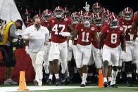 Alabama head coach Nick Saban, front left, jogs onto the field with his team for their Rose Bowl NCAA college football game against Notre Dame in Arlington, Texas, Friday, Jan. 1, 2021. (AP Photo/Ron Jenkins)