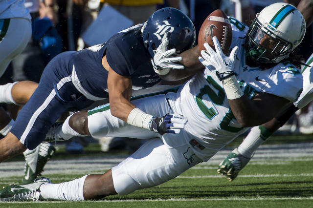 Tulane running back Rob Kelley (28) fumbles as he is hit by Rice cornerback Bryce Callahan (29) during the first quarter of an NCAA college football game at Rice Stadium, Saturday, Nov. 30, 2013, in Houston. Rice recovered the fumble. (AP Photo/Houston Chronicle, Smiley N. Pool)