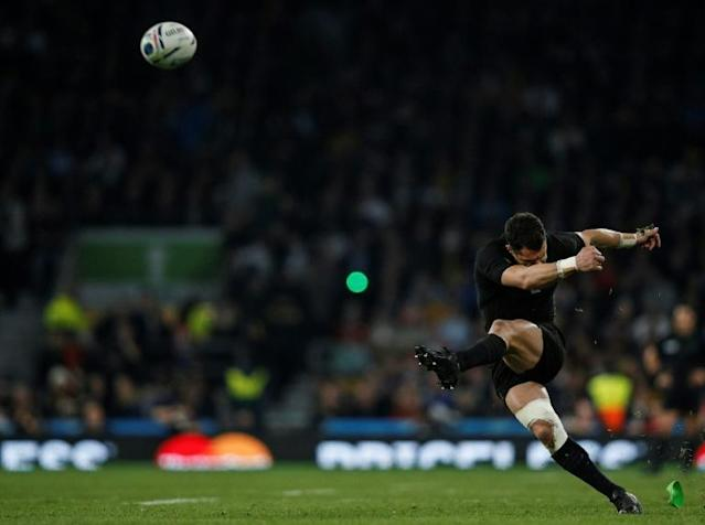 (FILES) In this file photo taken on October 31, 2015 New Zealand's fly half Dan Carter converts his team's second try during the final match of the 2015 Rugby World Cup between New Zealand and Australia at Twickenham stadium, south west London. Another disaster for England, as they became the first host nation to fail to reach the quarter-finals, beaten in their pool by both Wales and Australia. Ireland finally looked as though they were going to make their presence felt at a World Cup, beating France in a fierce contest to top their pool but they then succumbed to Argentina in the quarter-finals. Georgia gave notice of their growing ambitions with two wins in their pool and a good showing against the All Blacks but they didn't make the last eight. Japan also missed out in spite of an historic and thrilling last-minute win over South Africa, probably the greatest shock result in World Cup history. The Boks regrouped and began to shape as real contenders when they saw off Wales in the last eight but the All Blacks then edged a monumental semi-final 20-18. New Zealand took charge of the final against Australia before the Wallabies staged a second half rally. (AFP Photo/Adrian DENNIS)