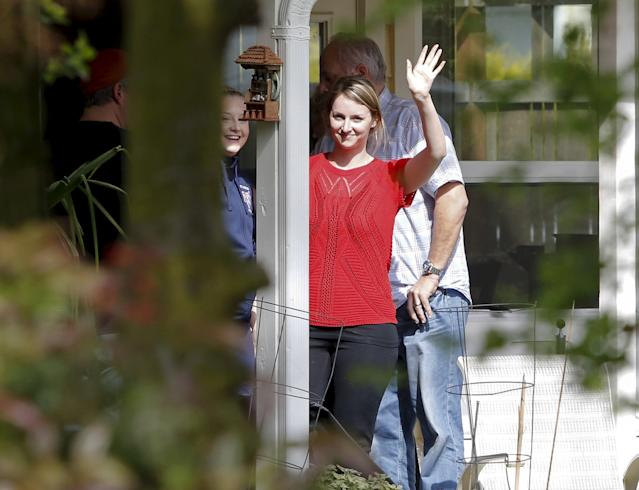 Unidentified people celebrate after Italy's highest court overturned Amanda Knox's conviction, at the home of Knox's mother in Seattle, Washington March 27, 2015. Italy's top court on Friday annulled the conviction of American Amanda Knox for the 2007 murder of British student Meredith Kercher and, in a surprise verdict, acquitted her of the charge. The Court of Cassation threw out the second guilty verdict to have been passed on Knox, 27, and her Italian former boyfriend Raffaele Sollecito for the lethal stabbing. REUTERS/Jason Redmond