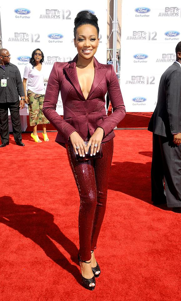 "We're on the fence with this one. Help us decide... Was the berry-colored suit <a target=""_blank"" href=""http://music.yahoo.com/monica/"">Monica</a> wore to the BET Awards fierce or fug? (7/1/2012)"
