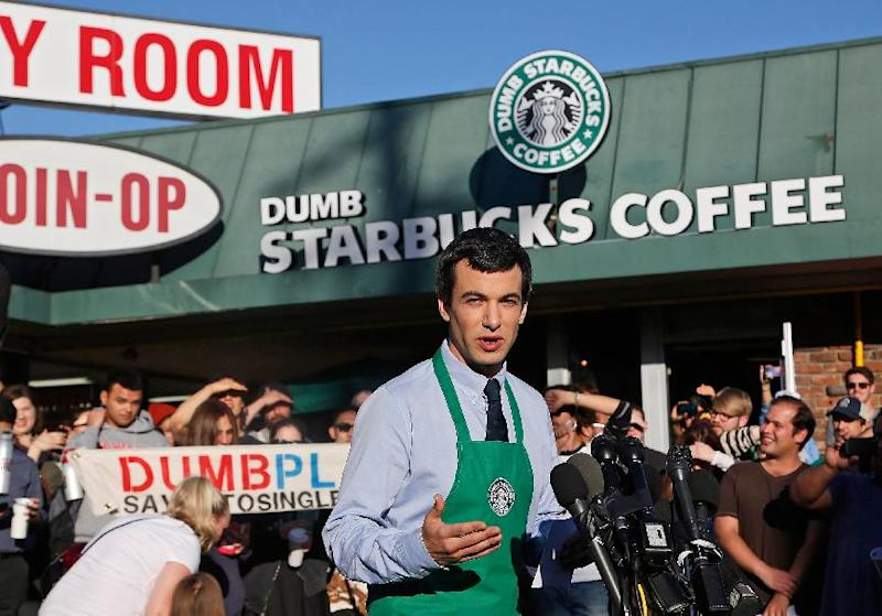 """Canadian comedian Nathan Fielder of the Comedy Central show """"Nathan For You"""" comes forward as the brainchild of """"Dumb Starbucks,"""" a parody store that resembles a Starbucks with a green awning and mermaid logo, but with the word """"Dumb"""" attached above the Starbucks sign. Starbucks Coffee spokeswoman, Laurel Harper says the store is not affiliated with Starbucks and, despite the humor, the store cannot use the Starbucks name. (AP Photo/Nick Ut)"""