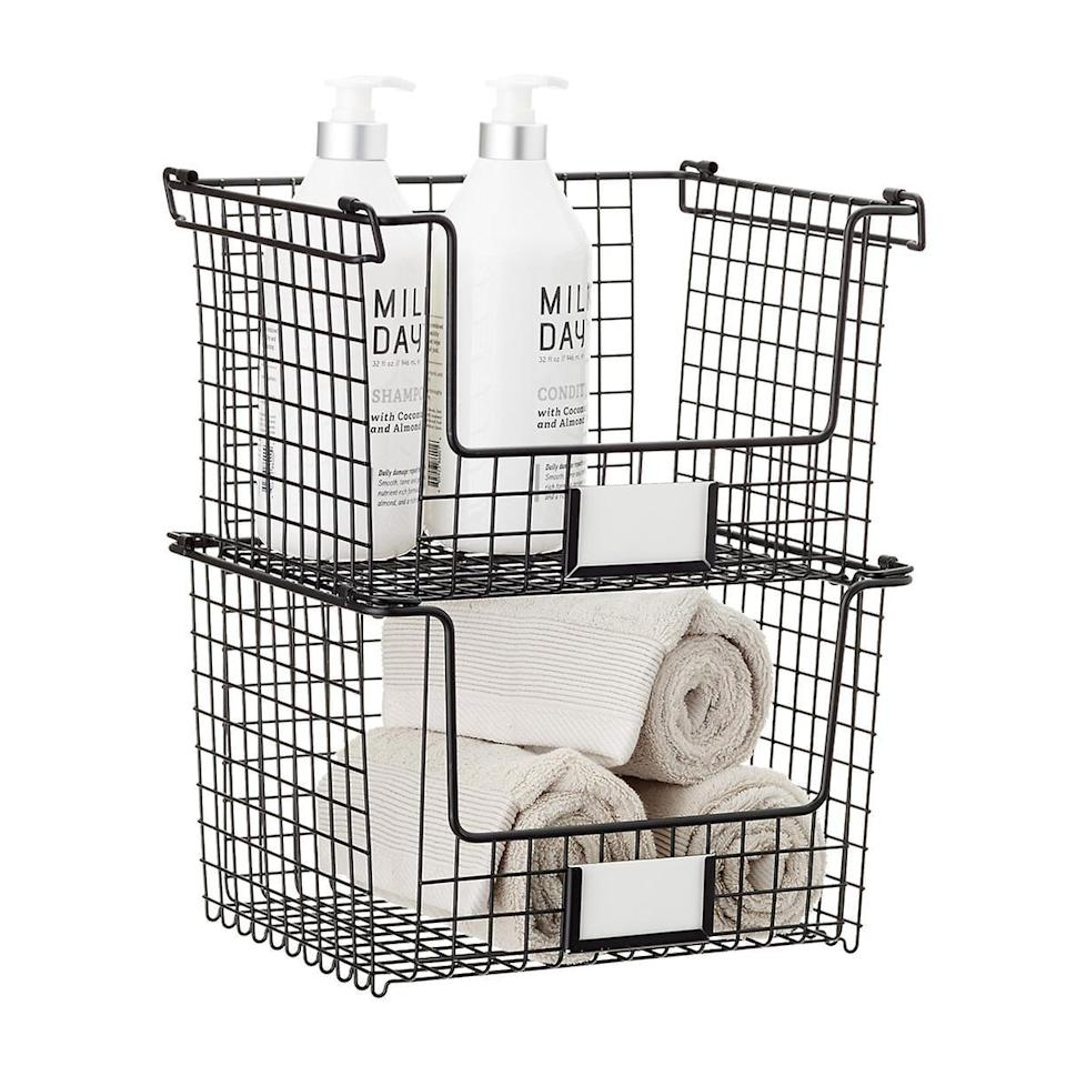<p>Keep your linen closets and cabinets organized with this <span>iDesign Black Stackable Basket</span> ($22). You can use these to store cleaning supplies, extras of your toiletries, wash clothes and towels, and more.</p>